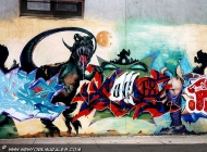 Dragon and flames going into the woman's back | Dragon | New York Murales