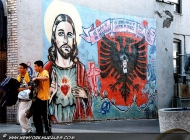 A murales against the war in Kosovo. In the bronx there is a large number of Churches and people here is very religious. That's why we can find murales with the Jesus icon on | Kosovo | New York Murales
