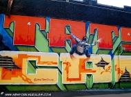A climber spraying a wall | Sprayer | New York Murales