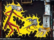 A surrealistic scene: an hammer taking a nail for a walk, scaring a cat | Surrealistic scene | New York Murales