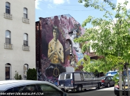 An house painted with a man and surrealistic background | Painted house | New York Murales