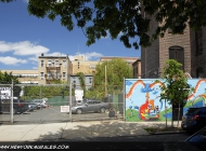 A childish murales, with so many rainbows, a lake and children playing | Rainbow | New York Murales