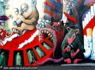 A fetus is smoking a cigarette, as told by the boss of the tobacco industry. His octopus arms show death people surrounging the baby. A rat, allied with the boss, got the business | Detail of the baby against tobacco industry | New York Murales