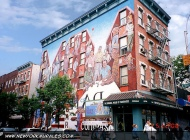 An entire building covered with murales | Building | New York Murales
