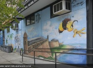A bee flying out from a castle, over the sea | A bee | New York Murales
