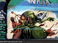 A kind of green monster eating an old style record player | Long Island | 5 Pointz | New York Murales