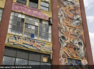 Skulls and flames on the side of the building | Long Island | 5 Pointz | New York Murales