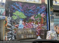A dragon and some coloured spray paints in the front | Long Island | 5 Pointz | New York Murales