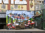 A cartoon style murales that seems Snow White and the seventh dwarfs | Long Island | 5 Pointz | New York Murales